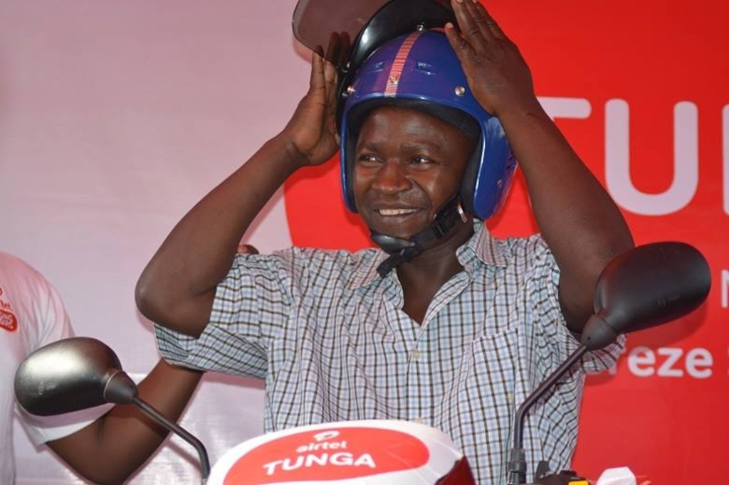 Winner 4 - Ngirinshuti Salomon posing on his new Airtel ...